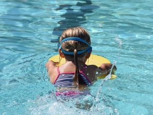 young swimmer in pool